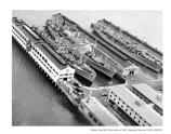 Aerial view of the Fort Mason Pier with transport ships, c1950s.