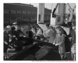 Caption States: Visit of California School for Blind Pupils to the USAT General D.E. Aultman at Fort Mason, 8 November, 1948. Inspecting the seven-ton spare anchor on the starboard side forward. Photograph taken by : Harry Knot.