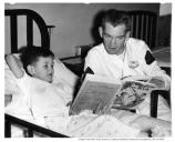 Sgt. Youngblood Reads to a Young Patient