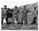 "MPs with dogs at Nike Site, Fort Barry, SF-88, c. 1970. ""L to R: 1) Randy Arnett and Brandy (dog), 2) ? and Sigmund, 3) ? and 4) Chuck Dyson and Baron"""