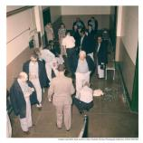 Alcatraz inmates arriving at the main cell house, c1960. Leg irons and handcuffs can be seen on most of the inmates.