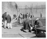 Alcatraz inmates playing dominoes and baseball in the recreation yard, c1935-1960.