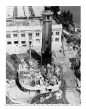 Aerial view of the remains of the lighthouse building on Alcatraz. The building was burned during the Indian Occupation period, 1969-1971. Photograph taken: c1970.