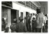 Ranger Ruth Lawrence with a group of youths in Alcatraz cell block, wider shot, c. 1979.