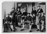 Eight soldiers on a porch, presumably in the Presidio, c1900