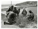 Ranger April Eya with group of youth looking at a bush, Rodeo Beach and Lagoon, near Fort Cronkhite, 1980.