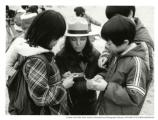 Ranger Vicki Card with children looking at a compass, Marin Headlands, 1980.