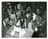 """Arrival of Santa Claus at the Enlisted Men's Club, Presidio. 22 December 1952 [Christmas party]."""