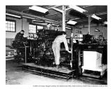 Members of the 21st Engineering Corps monitor maps coming off presses, c1950