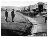 Troops marching past the barracks and the main parade ground in the Presidio, c1898.