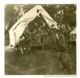 Group of soldiers in the tent housing at the East Cantonment of the Presidio during the Spanish American War, 1898.