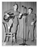 Two soldiers sing and play guitar for the War Bonds Entertainment show, September 21, 1945.