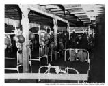 Caption states: Interior of two story barracks at North Garrison, Fort McDowell. Original capacity of 60 was doubled by 'upside down' arrangement of beds. This and other barracks have individual oil heating units... August 27, 1942.