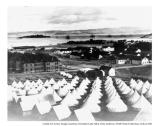 Presidio's main parade grounds, brick barracks, and headquarters from the hill behind the troops tents, 1898