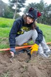 A volunteer in Sutro Heights at an archaeology site