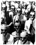 Group of men and soldiers wearing the army issue gas mask, cWWII.