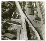 Aerial of Doyle Drive, with Crissy Field and trains on one side and Building 201 on the other, 1950.
