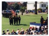 Army members carrying flags to officers' podium in deactivation ceremony, 1994
