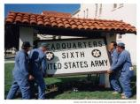 Removing 6th Army sign in deactivation ceremony, 1994.