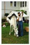"Man with horse in ""Living History"" event in front of Building 2, Presidio Museum. Post to Park week, October 1994."