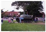 Children playing on Presidio parade ground tank in Post to Park celebration, October 1994.
