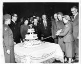 Two nurses cutting the cake at the celebration for the 56th Anniversary of the Army Nurse Corps at the Public Health Services Hospital in the Presidio, c1957,