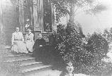 Muir family on front porch of the Martinez home.