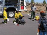 A Junior Firefighter learns about fire equipment during a fun weekend at the Monument.