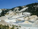 The Bumpass Hell Trail turns into a boardwalk to view the thermal features up close.