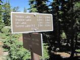 Upon an intersection, hikers will notice a sign indicating the direction to the last lake, Cliff Lake or to Paradise Meadow.