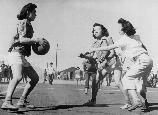 Basketball games are part of the regular scheduled recreational events, which help to fill out the lives of residents in relocation centers. These girls are participating in a nip and tuck game, which frequently brought the spectators to their feet.