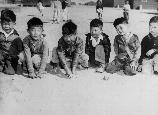 These youngsters are playing in the field of a nursery school at Manzanar, a War Relocation Authority center where evacuees of Japanese descent will spend the duration.