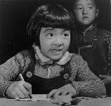 A third grade student at the Manzanar Relocation Center for evacuees of Japanese ancestry practices free-hand drawing. This photo was taken in the student training center where student teachers are given college credit for their practice teaching. Miss Kiyo Fukasawa is the student teacher and is supervised by a Caucasian teacher, as are all the student teachers.