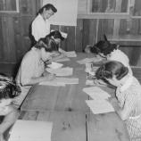 Part of a class under the Adult Education Program at this War Relocation Authority center. It is composed of Issei and Kibei evacuees who are studying the Ideals of American Citizenship and the English language with which they are unfamiliar . There are 18 such classes, each averaging 20 volunteer members and conducted by volunteer instructors.