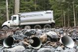 A rock truck crosses the new culverts at Kautz Creek, on its return trip from a delivery to milepost 9.1.