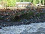 Debris litters the river in front of the Emergency Operations Center the day after the storm.