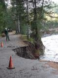 Park trails foreman Carl Fabiani documents damage to the Community Building road at Longmire.