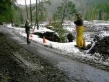 Park road crews inspect damaged roads at Longmire.