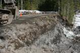 Work begins to rebuild the road embankment at milepost 9.1.