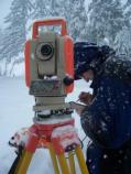Graduate student Scott Beason conducts river surveys in the snow.