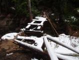 The new Silver Falls bridge was heavily damaged by the flood.