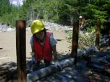A maintenance volunteer builds an accessible boardwalk at Kautz Creek