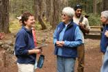 Flood Recovery Corps director Jill Baum chats with Student Conservation Association founder Liz Titus Putnam in the Longmire Campground during a visit by SCA's board of directors.