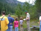 Student Conservation Association intern James Anderson interprets the history and ecology of the Longmire Meadow.