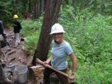 Student Conservation Association intern Susan Newman helps repair damage on the Comet Falls Trail.