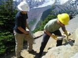 Volunteers help rebuild a rock wall along the trail at Sunrise, in Mount Rainier National Park.