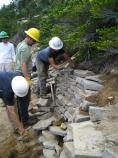 Volunteers help rebuild a rock wall along the trail at Sunrise, in Mount Rainier National Park, under the direction of crew leaders from the Student Conservation Association and Washington Trails Association.