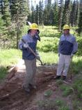 Father and son volunteers Taylor and David Barbrack help maintain trails at Indian Henry's Hunting Ground.