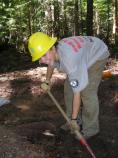 A Conservation Land Corps/Hurricane Katrina Recovery Corps volunteer helps reroute a section of the Wonderland Trail near Cougar Rock, in Mount Rainier National Park.