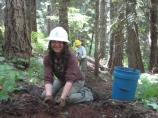 SCA Crew Leader Liz Brown works on Wonderland Trail repairs in Stevens Canyon during an SCA alumni event.